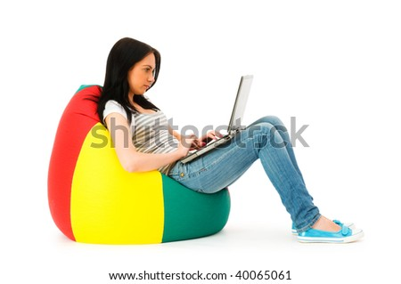 Girl working on laptop isolated on white