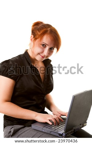Girl working with laptop on her knees