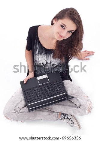 Girl working with laptop. Picture on a white background.