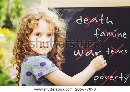Girl writes in chalk on a blackboard. Peace concept. Toning photo. - stock photo