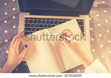 girl writes in notebook  - stock photo