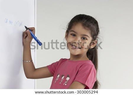 Girl writing on a board - stock photo