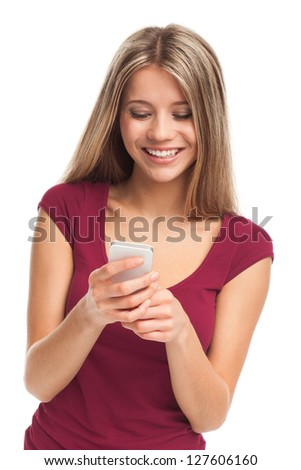 Girl writing or receiving a message on her phone, on white