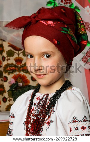 Girl 6-7 years brunette in Ukrainian national costume in a scarf - stock photo