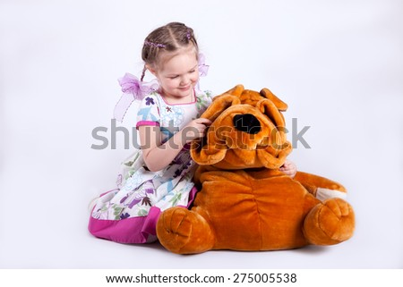 girl 4 years old sitting with dog - stock photo
