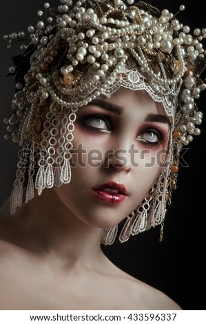 Girl zombie with beautiful vintage decorated hat