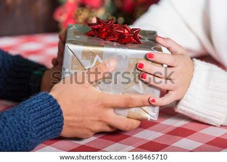 Girlfriend and Boyfriend exchanging Christmas Gifts - stock photo