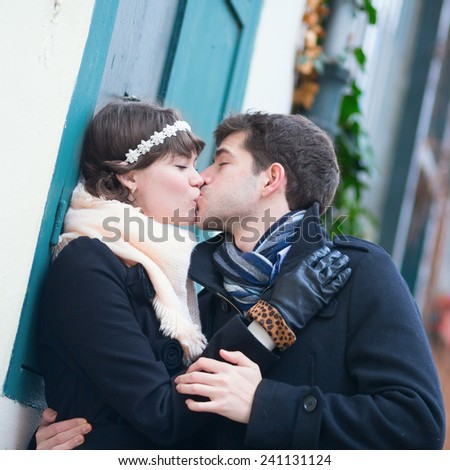 Girlfriend and boyfriend kissing each other outdoors - stock photo