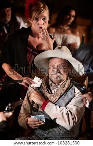Girlfriend passes ace of spades card to worried gambler - stock photo