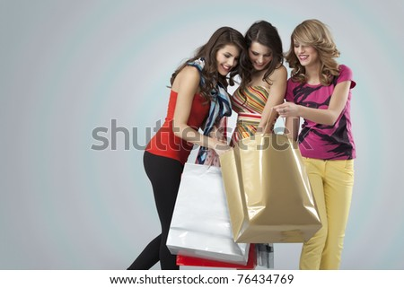 girlfriends looking happy shopping
