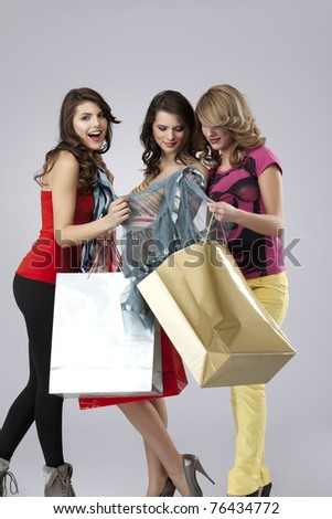 girlfriends looking happy shopping - stock photo