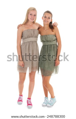 Girlfriends standing in de studio isolated over white background - stock photo