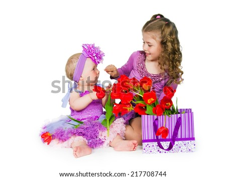 Girls and many color paper packages  - stock photo