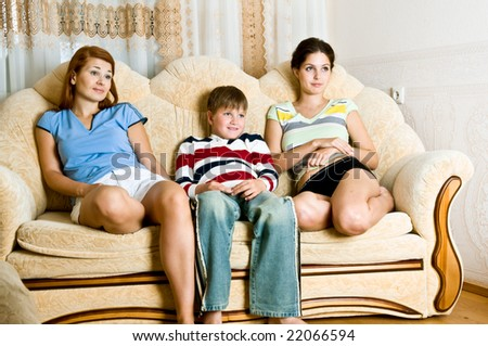 Girls and the boy on sofa