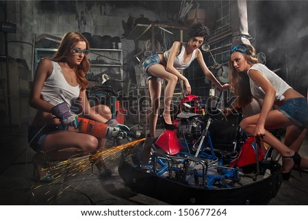 Girls at a garage next to the Go-kart  in smoke - stock photo