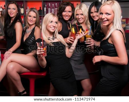 Girls company having fun in the night club - stock photo