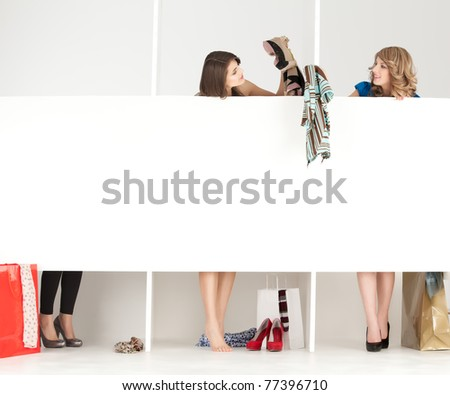 girls discussing over clothes in shop wordrobe