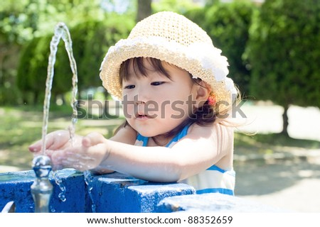 Girls drink tap water in the park