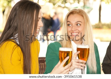 girls drinking beer outdoors