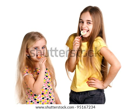 girls eat candies on awhite background