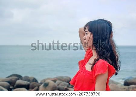 Girls enjoy nature at the beach  - stock photo