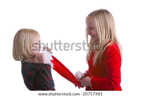 Girls fighting over a santa hat in Christmas dresses
