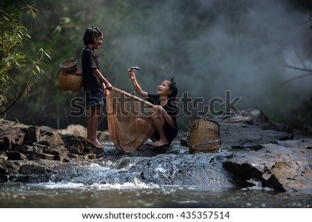 Girls fishing on the river. - stock photo