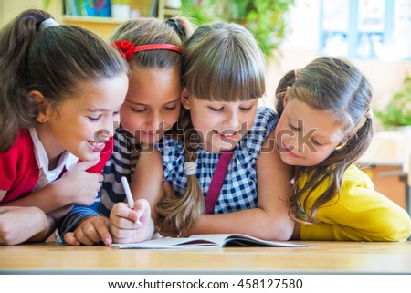 girls from elementary school together decide to learn from notebook