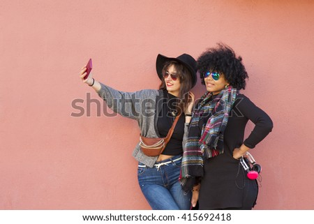 girls getting a selfie with mobile