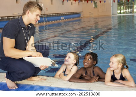 Girls having swimming lesson - stock photo