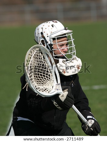 Girls high school lacrosse goalie. Editorial use only.