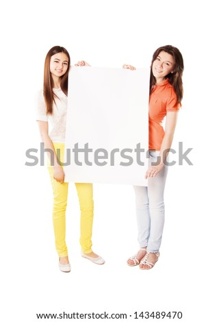 girls hold white blank paper - stock photo