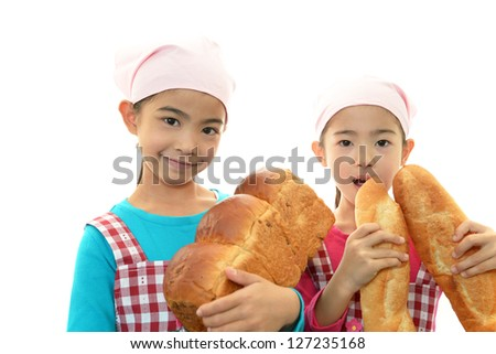 Girls holding bread - stock photo