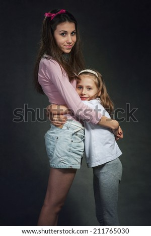 Girls hug - stock photo