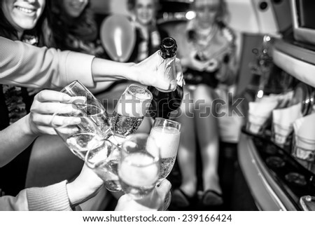 Girls in limo at hen-party, black and white - stock photo