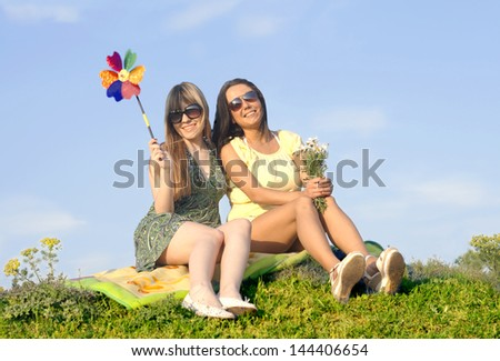 girls in nature with windmill - stock photo