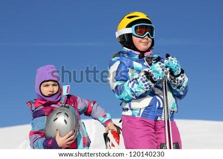 Girls in ski equipment - stock photo
