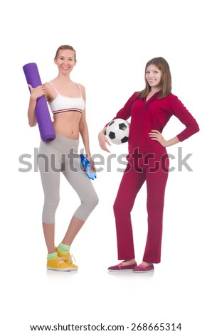 Girls in sport costumes isolated on white - stock photo
