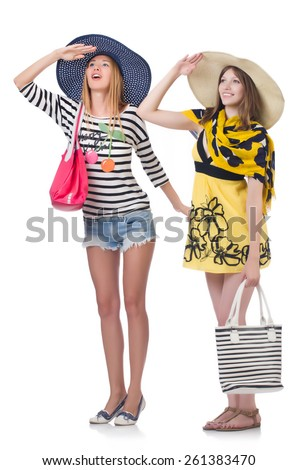 Girls in summer clothing with bags isolated on white - stock photo