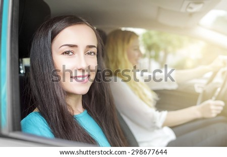 Girls in the car. Two attractive woman in car, close-up. Travel concept. - stock photo