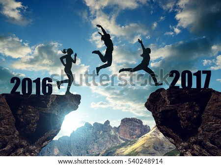 Girls jump to the New Year 2017 at sunset.