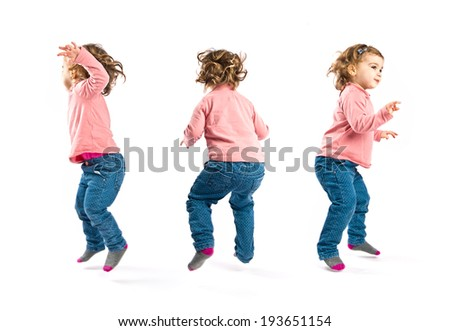 girls jumping over isolated white background - stock photo