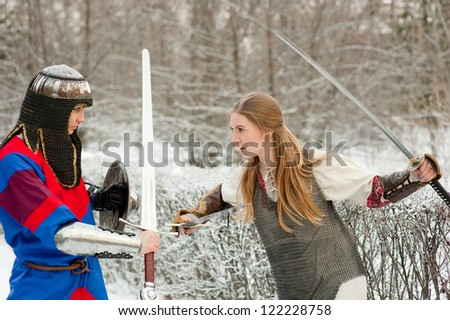 Girls knights fight with swords - stock photo