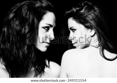 Girls looking at each other black and white - stock photo