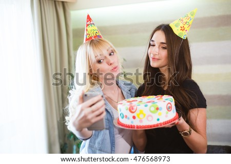 Girls make selfie at a birthday party.