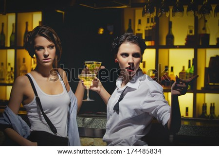 Girls night out having drinks at the bar - stock photo