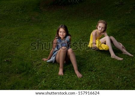 girls on the ground - stock photo