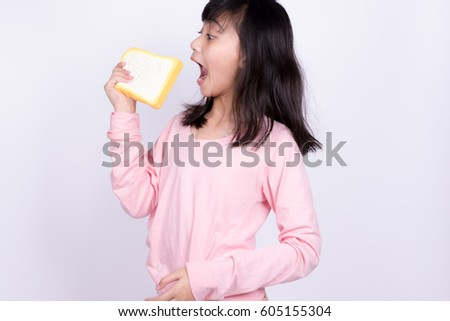 Girls pink shirts eat bread on white background
