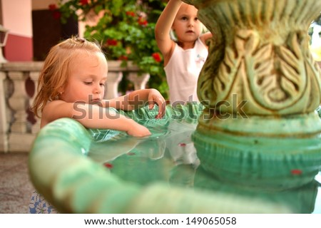 girls play by Fountain  - stock photo