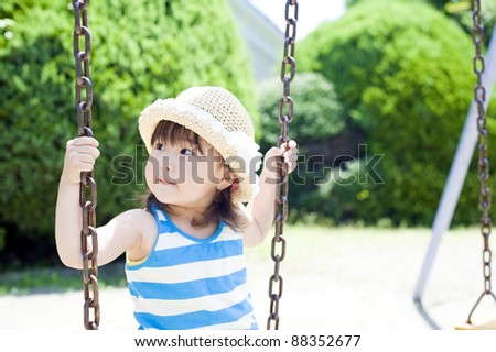 Girls play on the swing in the park